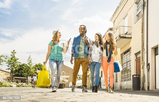 861023492 istock photo Multiracial friends group having fun together walking on town street - Everyday lifestyle and friendship concept on springtime - Young people hanging out together after shopping - Bright vivid filter 657567330