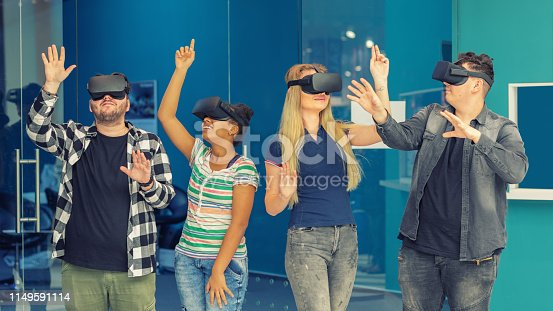 istock Multiracial friends group playing on vr glasses indoors - Virtual reality and wearable tech concept with young people having fun together connecting with headset goggles - Digital generation trends 1149591114