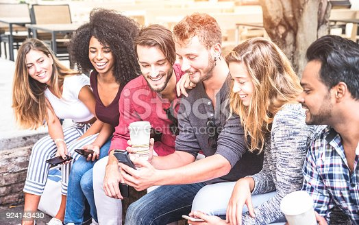 istock Multiracial friends group using smartphone at university college - Young people addicted by mobile smart phone - Technology concept with connected trendy millennials - Soft pink pastel sunshine filter 924143430