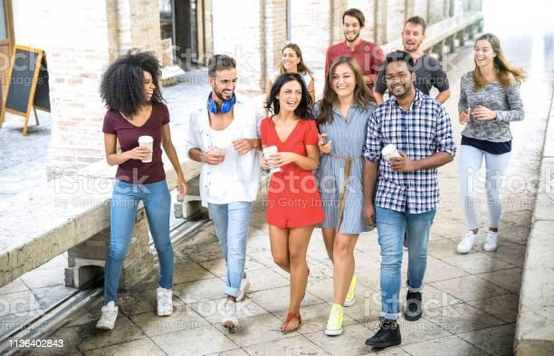 Multiracial friends group walking in city center happy guys and girls picture id1136402843?b=1&k=6&m=1136402843&s=612x612&h=h0ngzsum0eea1sr6q17xvp2l4t vdqtxmrvg  upccw=