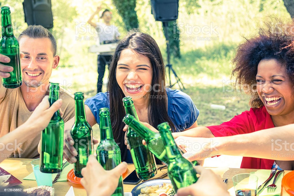 Multiracial friends having fun at barbecue garden party stock photo