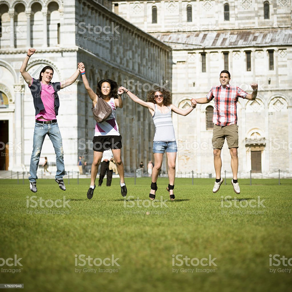 Multiracial Friends jumping on the grass royalty-free stock photo