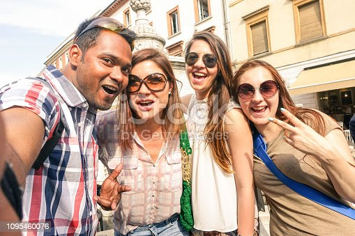 861023492istockphoto Multiracial friends taking selfie at city tour - Happy friendship concept with gen z student having fun together - Millenial people on peace love concept against racism - Warm bright outside filter 1095460076