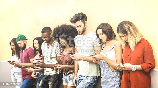 istock Multiracial friends using mobile smartphone at university coampus - Millenial people addicted by smart phones - Tech concept with always connected millennials on social networks - Bright warm filter 1132828276