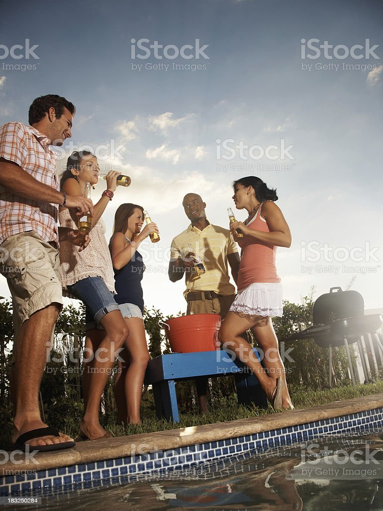 Multiracial friends with beer bottles enjoying their vacation stock photo