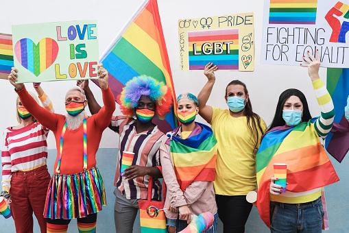 Multiracial gay people at LGBT pride event during coronavirus outbreak - Soft focus on senior man