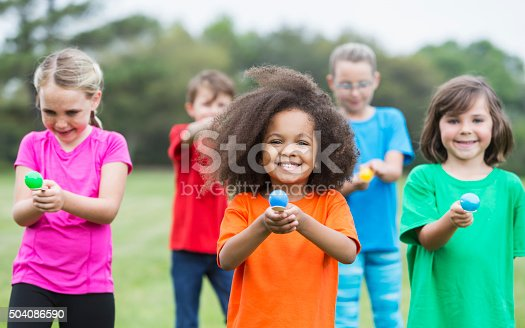 istock Multiracial group of children in an egg spoon race 504086590
