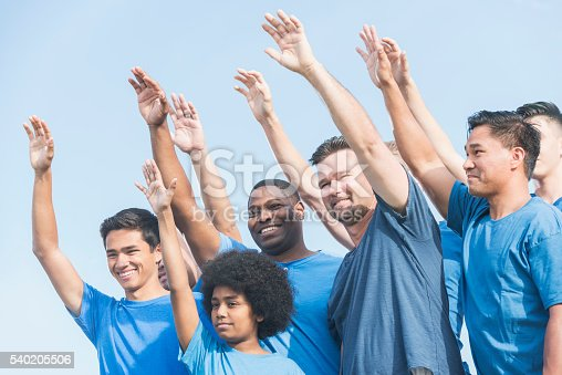 866758230 istock photo Multiracial group of fathers and sons raising hands 540205506