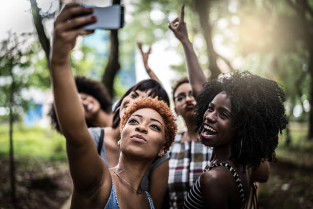 Multiracial group of friends taking selfie stock photo