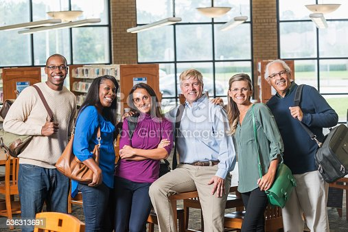 876965270 istock photo Multiracial group of mature students in library 536313691