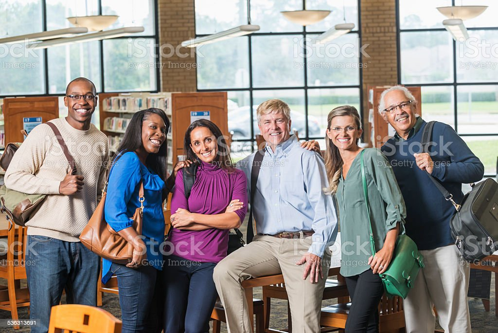 Multiracial group of mature students in library stock photo