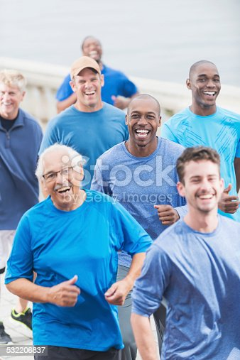 istock Multiracial group of men in blue shirts running 532206837