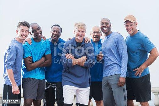 istock Multiracial group of men wearing blue shirts 537852571