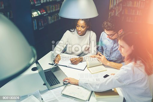905130626 istock photo Multiracial group of students browsing and analyzing information from web making strategy planning for common project collaborating, coworkers having brainstorming session on meeting in office 905130326