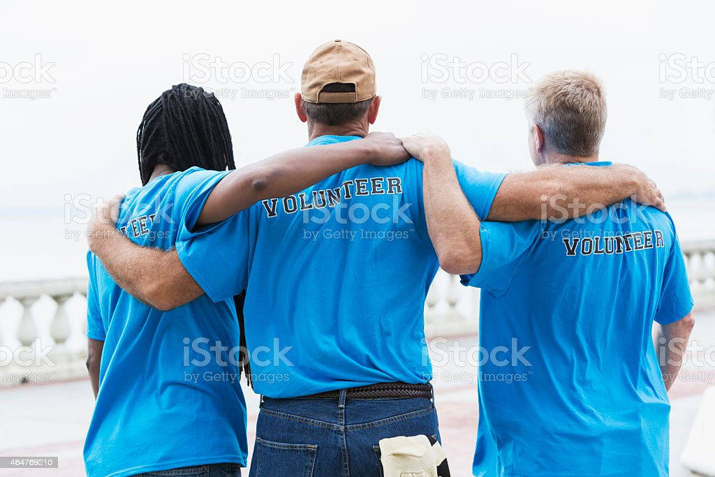 Multiracial group of volunteers standing together stock photo