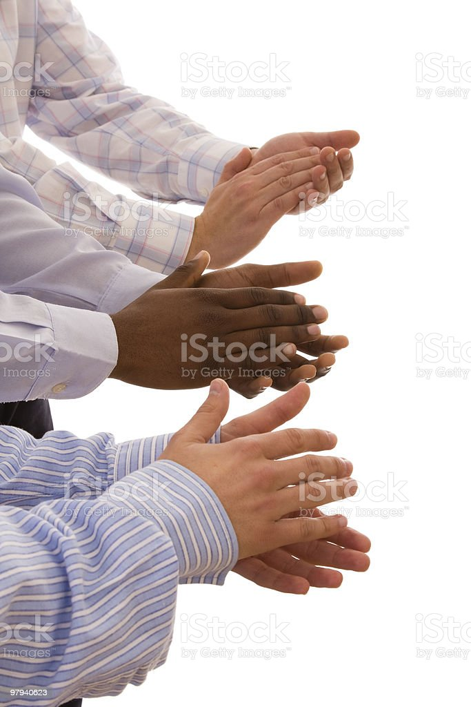 multiracial hands clapping royalty-free stock photo