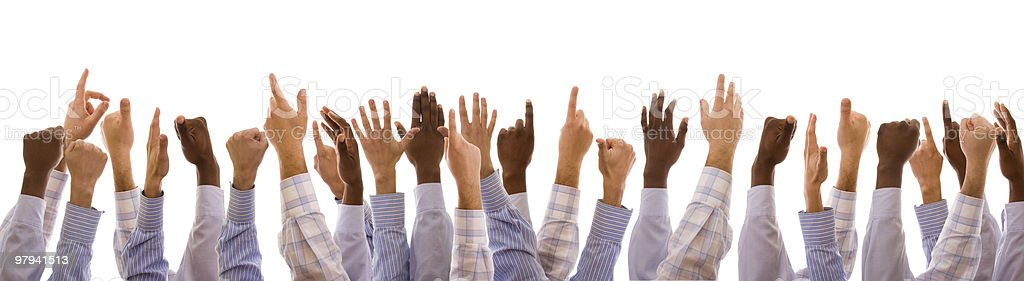 multiracial hands raised royalty-free stock photo