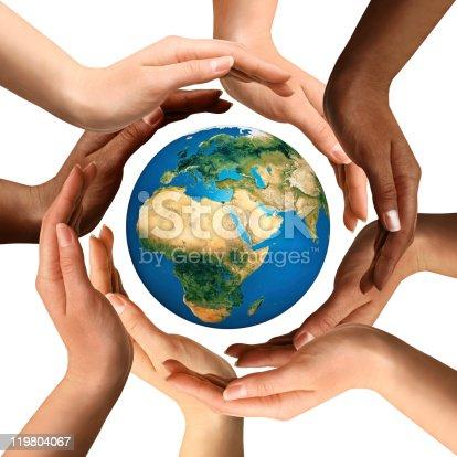 istock Multiracial Hands Surrounding the Earth Globe 119804067