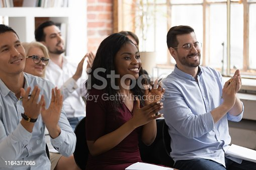 1016196912 istock photo Multiracial happy business audience people applaud thank for workshop presentation 1164377665