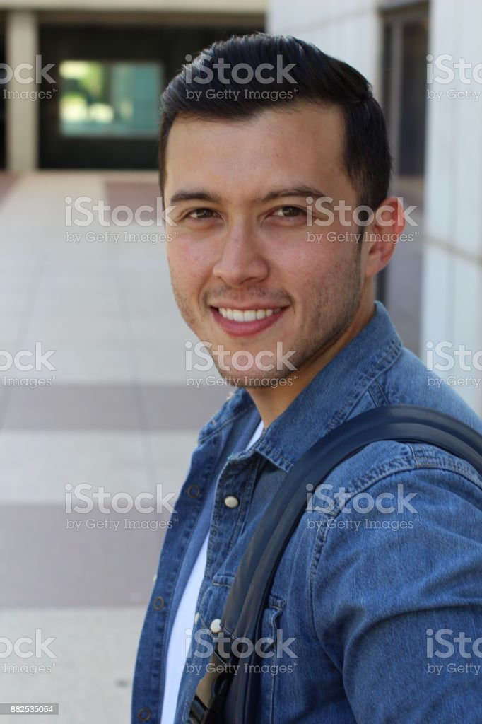 Multiracial male smiling with copy space stock photo