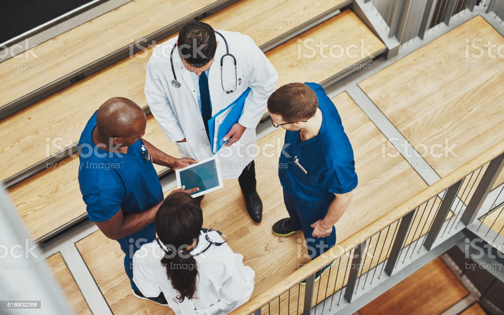 Multiracial medical team having a discussion stock photo