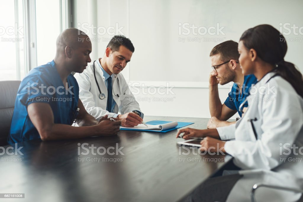 Multiracial medical team having a meeting stock photo