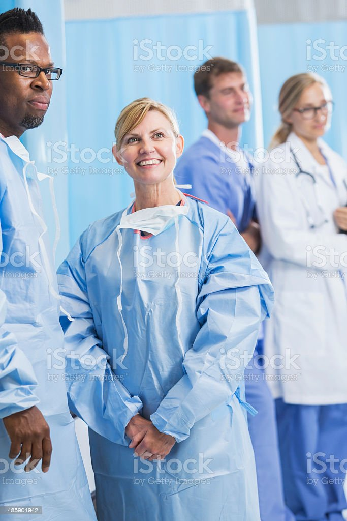 Multiracial medical team in hospital room stock photo