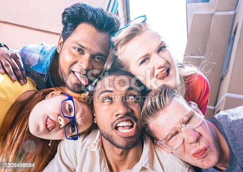 861023492 istock photo Multiracial millenial friends taking selfie sticking out tongue with funny faces - Happy friendship concept against racism with international young people having fun together - Bright vivid filter 1209498584