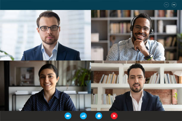 Multiracial participants of videoconference online meeting computer webcam screen view stock photo