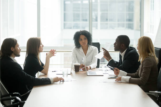 Multiracial people group having dispute about bad contract at meeting stock photo