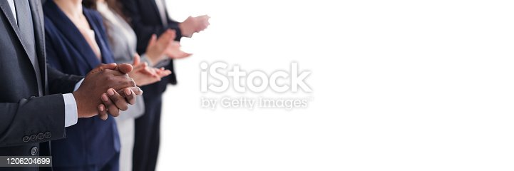 1042372612 istock photo Multiracial people hands applauding at business meeting 1206204699