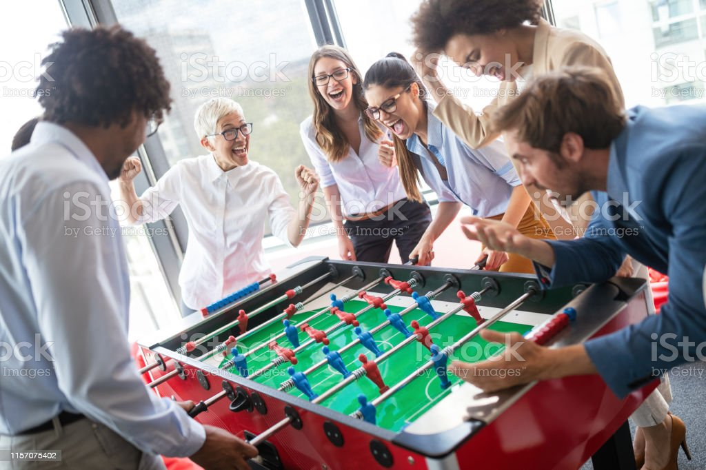 Multiracial team people having fun in office room, excited diverse...