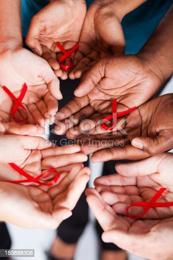 istock multiracial people holding red ribbon for AIDS HIV awareness 153888308