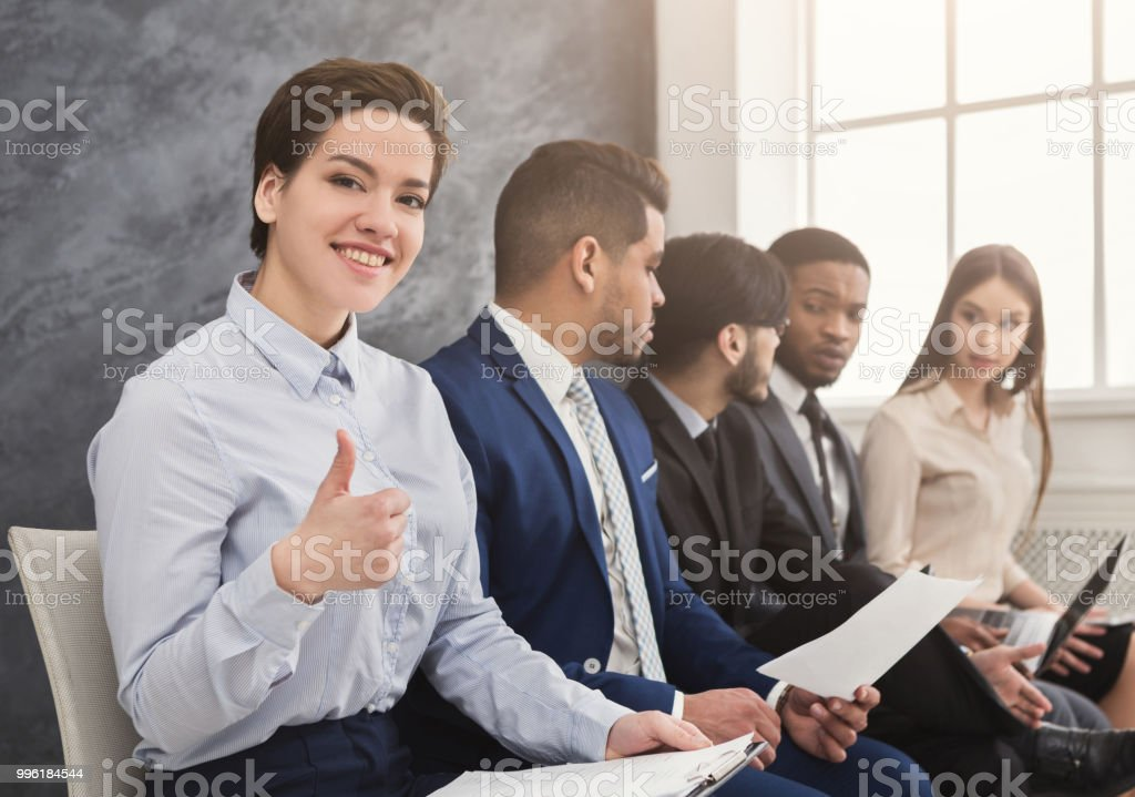 Multiracial people waiting in queue preparing for job interview royalty-free stock photo