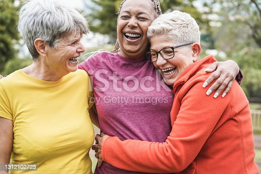 istock Multiracial senior women having fun together after sport workout outdoor - Main focus on african female face 1312102723