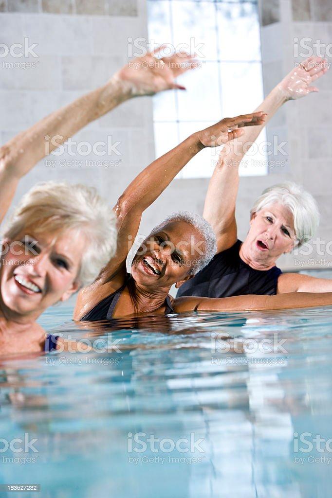 Multiracial senior women in water aerobics class royalty-free stock photo