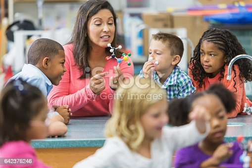istock Multiracial teacher and children in science lab 642376246