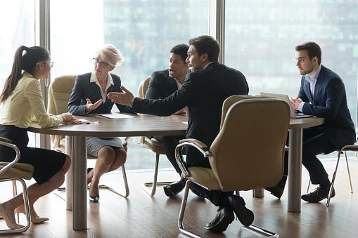 istock Multiracial team group disputing in office boardroom at meeting 1050287494