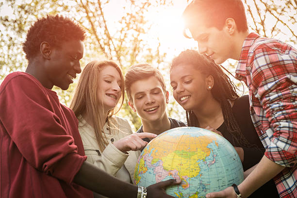 Multiracial Teen Couple Holding Globe Map - stock stock photo