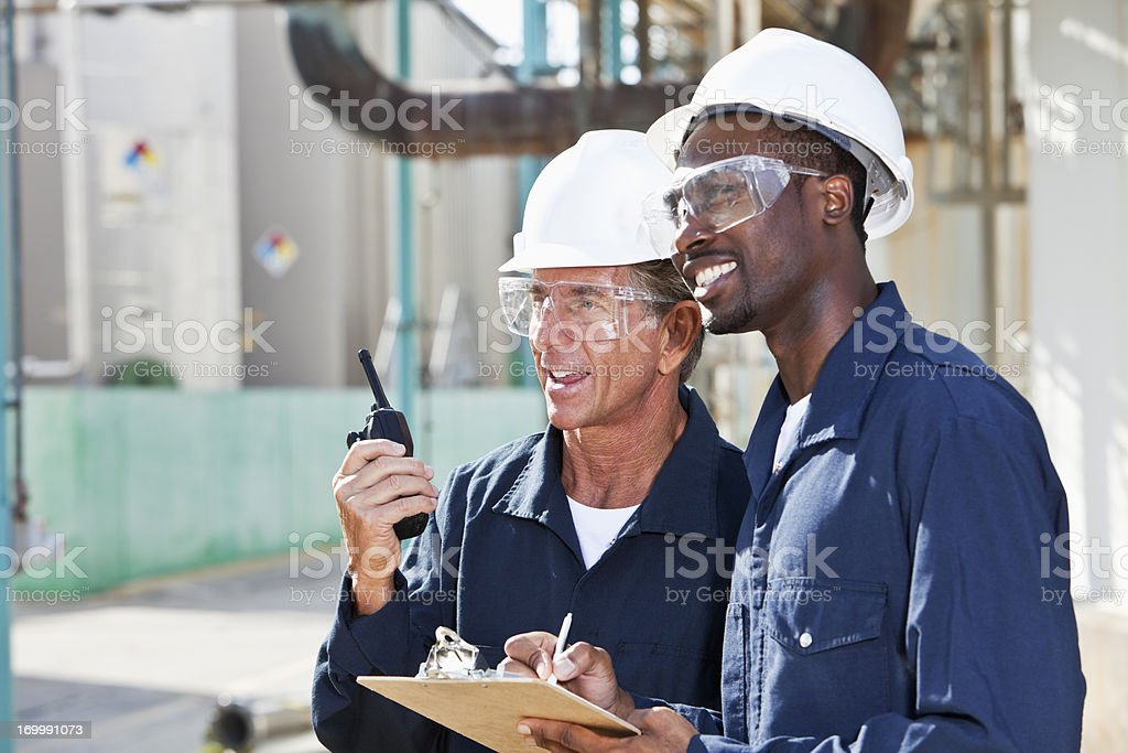 Multiracial workers at industrial plant stock photo