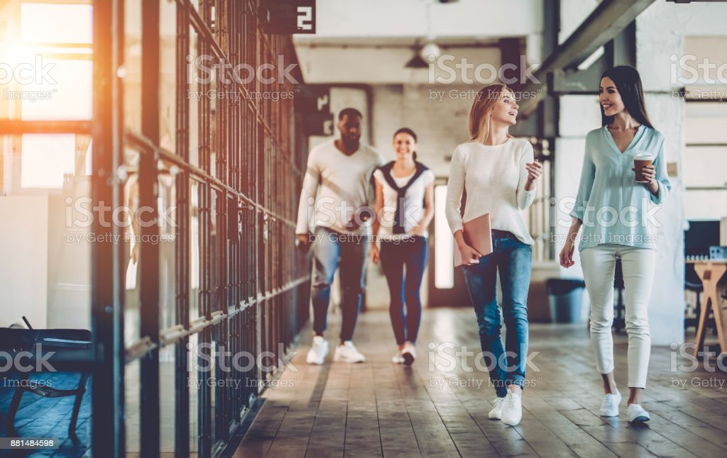 Multiracial young creative people in modern office. royalty-free stock photo