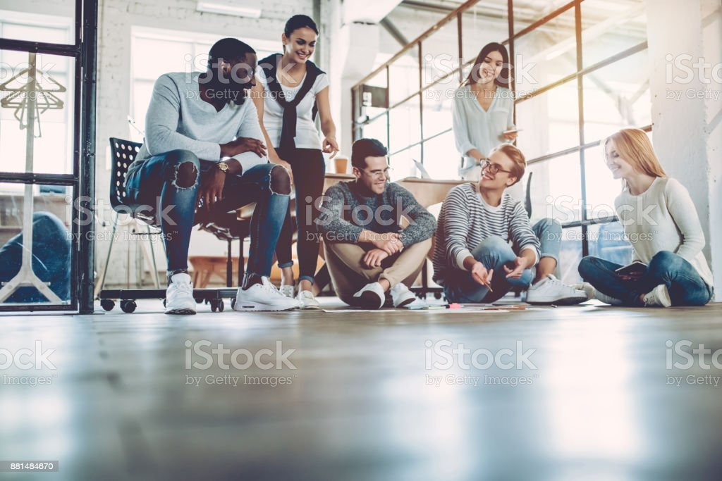 Multiracial young creative people in modern office. stock photo