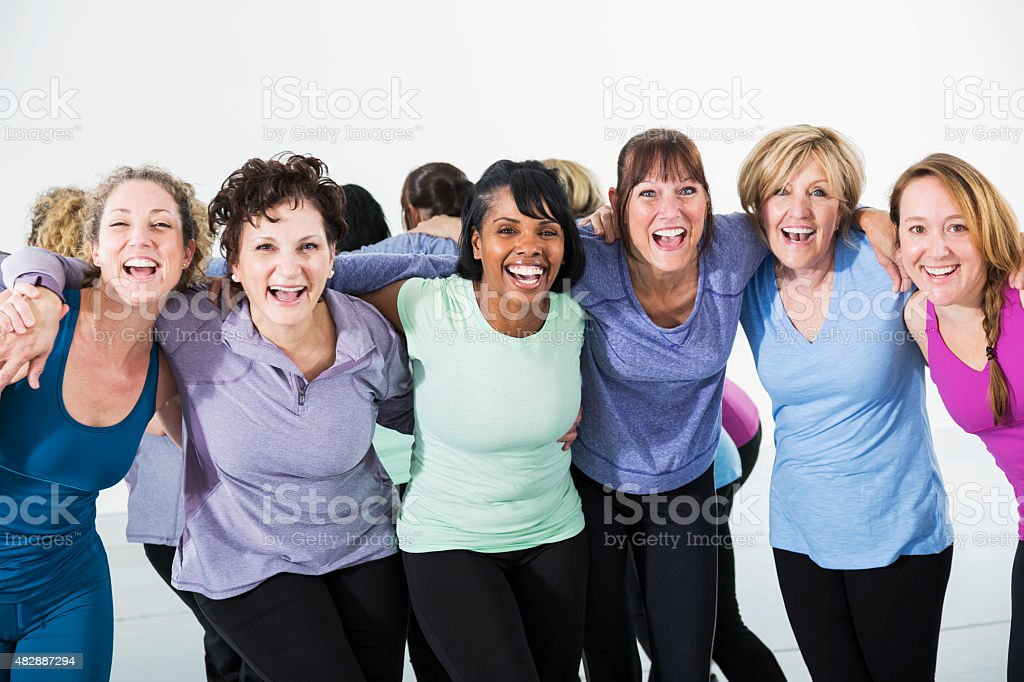 Multiraical group of women in exercise class stock photo