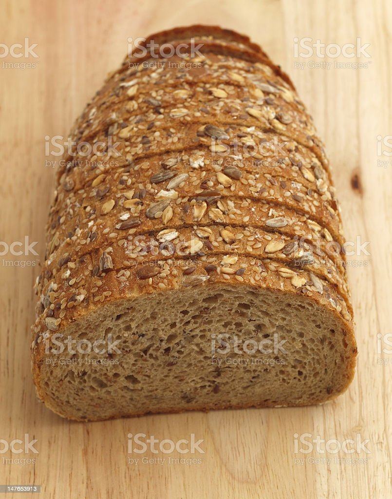multiseed bread on wooden board stock photo