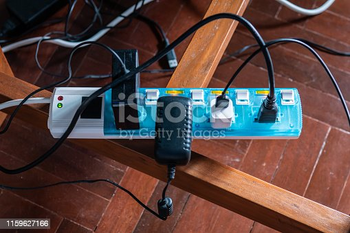 Multi-socket Power Strip with a bunch of plugs on it
