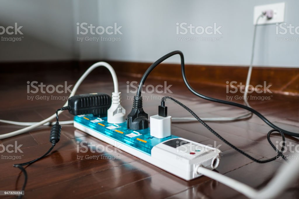 Multi-socket Power Strip with a bunch of plugs on it stock photo
