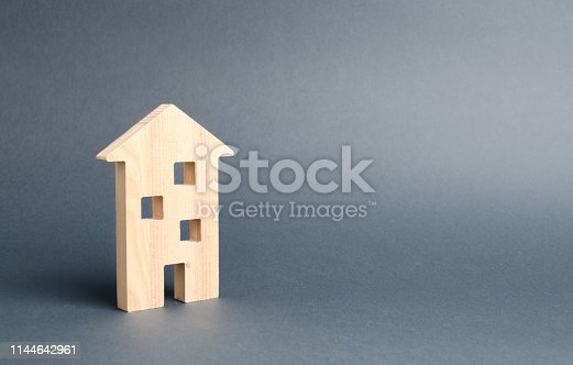 istock multi-storey building residential house on a gray background. Mortgage and credit for the purchase. Minimalism. Isolate Real estate concept, buying affordable housing, renting. Property tax. 1144642961