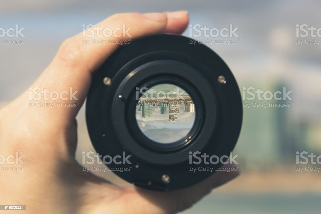 Multi-storey buildings and skyscrapers through a camera lens - image inside is inverted, urban landscape stock photo