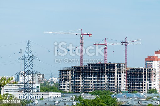 istock Multistorey multistorey buildings construction site with tower cranes and helicopters 578092946