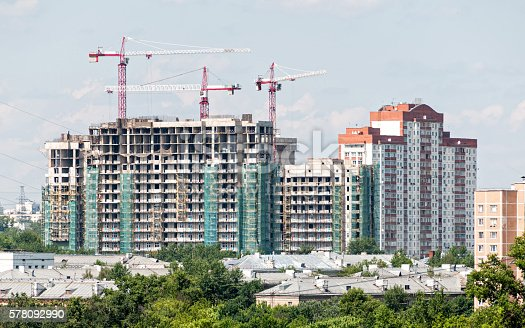 istock Multistorey multistorey buildings construction site with tower cranes 578092990